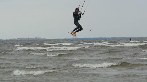 kitesurfer flying over the waves Live Action