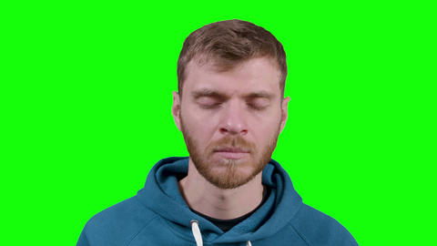 Man practicing yoga meditation indoors during 1 hour on green screen chromakey Live Action