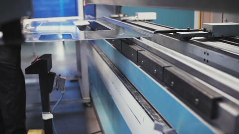 Operator working cut and bending metal sheet by high precision metal sheet Live Action