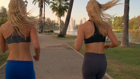 Athletic Twins Running Park Slow-Motion Footage
