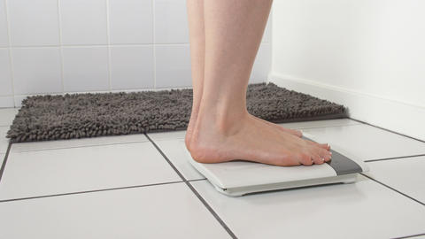 Woman Checking Weight Bathroom Scale Live Action