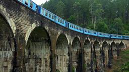 Train passing old Nine Arches Bridge. Famous travel destination in Sri Lanka Footage