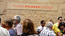 Visitors in front of the Picasso Museum in Malaga, hometown, Spain Footage