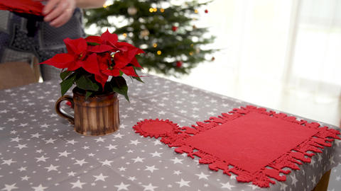 festive table setting for Christmas holidays. preparation of Christmas stars and Live Action