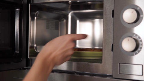 heating food in a microwave oven in the kitchen in the home Live Action