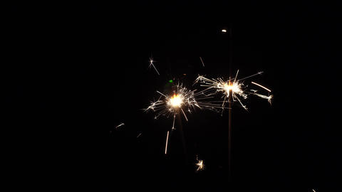Sparklers rotating in the dark Live Action