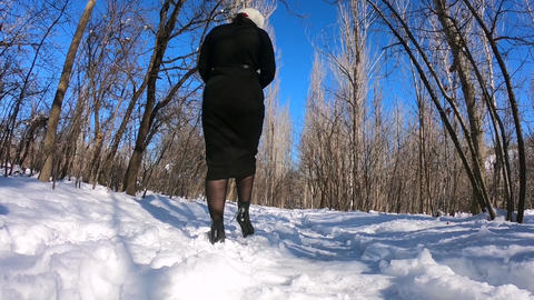 girl Walking in winter GIF