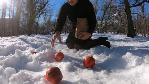 Girl and picking pomegranate from the ground GIF
