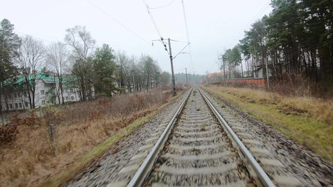 FPV drone flight along railway, front view Live Action