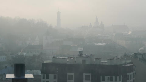 Timelapse of historic center of Lviv in dense fog. Silhouettes of buildings and Live Action