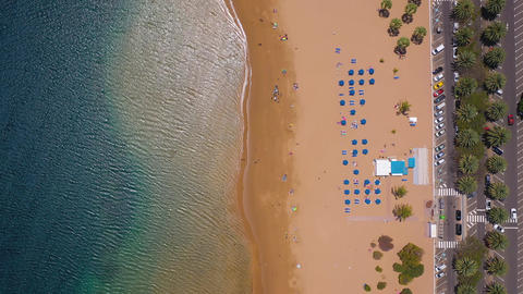Top view of Las Teresitas beach, road, cars in the parking lot, golden sand Live Action