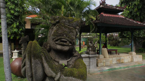 Old indonesian statue covered in moss, in a resort on Bali island, close up Live Action