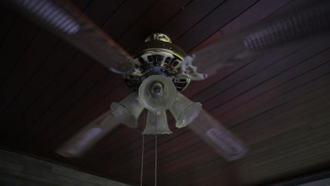 Ceiling fan is spinning, wooden ceiling Live Action