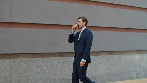 Side view business man drinking coffee to go. Man drinking take away coffee Live Action