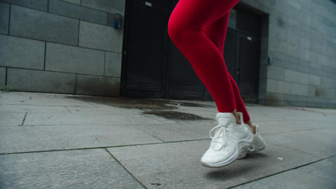 Female legs running on street road. Close up woman legs jogging outdoor Live Action