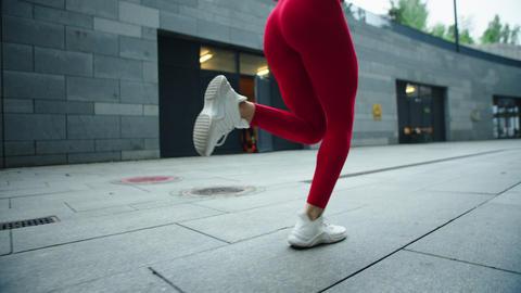 Female legs running on urban street. Closeup woman legs running outdoor Live Action