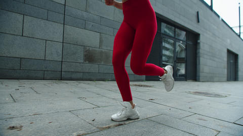 Girl legs running outdoor in slow motion. Close up female legs running on street Live Action