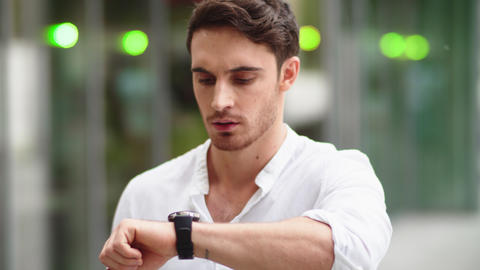 Closeup man checking notifications on smart watch. Guy using digital watch Live Action