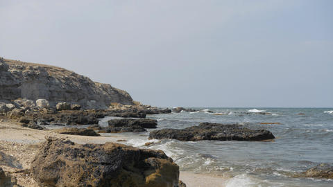 Waves break on the shore. Waves break on the rocks Live Action