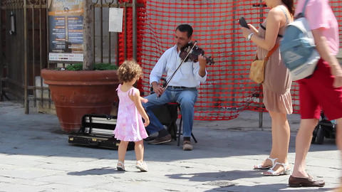 Man Playing the Fiddle in the Street of San Remo Footage