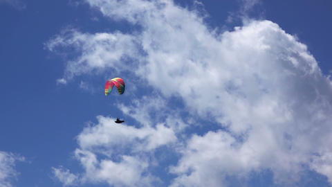 Paraglider on Blue Sky Background and Clouds Footage
