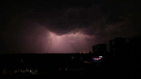 Thunderstorm and lightning in the night sky Live Action