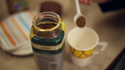 Scoop a spoon of instant coffee from the jar Footage