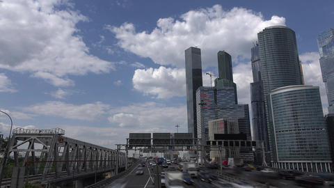 Modern city highway, busy traffic rush towards road split, glassy skyscrapers Footage