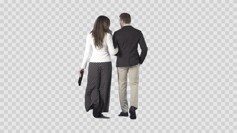 Attractive young couple are slowly walking from the camera. Alpha channel Footage