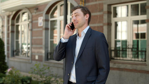 Closeup businessman having phone talk at street. man talking phone outdoors Live Action