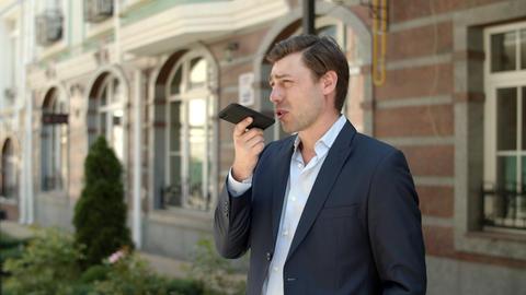 Closeup entrepreneur having phone conversation. Man…, Live Action