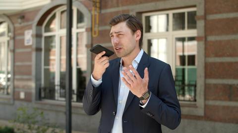 Closeup entrepreneur having phone conversation. Man recording voice messages Live Action