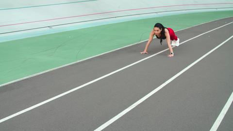 Athletic woman doing push ups exercise outdoor at athletic stadium Live Action