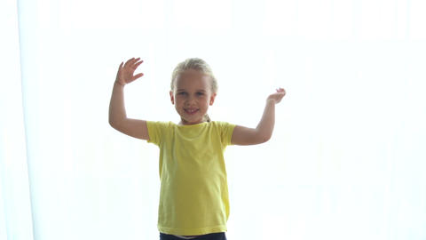 Preschooler little girl dancing movement. Slow motion shot. camera motion Live Action