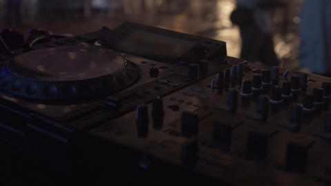 Footage of a professional DJ control panel before a concert on stage. DJ Midi Live Action