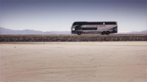 Bus Crossing Salt Flat In Argentina Live Action