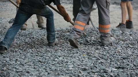 Workers Throw Gravel With Shovels Live Action