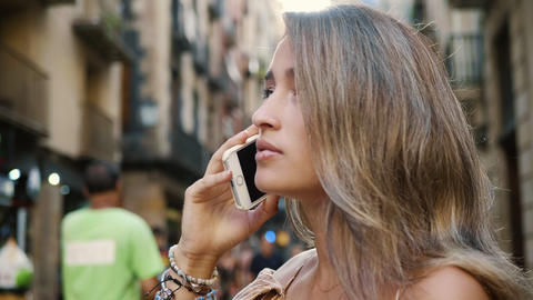 Closeup aggressive woman talking mobile phone. Angry woman feeling puzzled Live Action