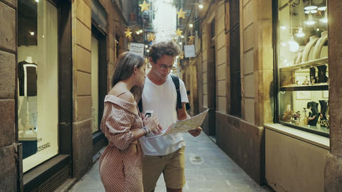 Focused student searching way with map. Pretty woman showing right way to man Live Action