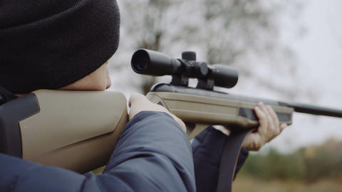 Hunter with gun on forest Live Action