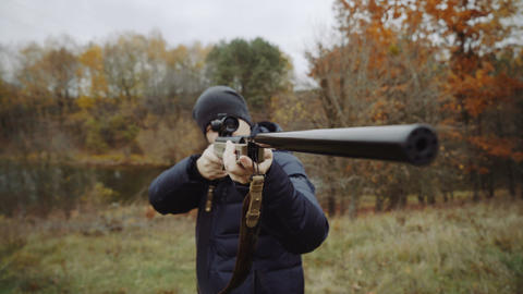 Man aiming with hunting rifle Live Action
