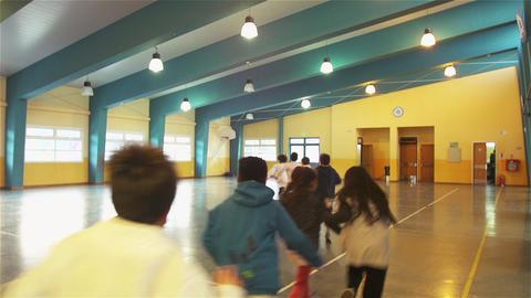 Group of Elementary School Kids Running in a School Corridor Live Action