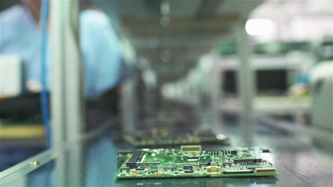 Electronic Circuit Boards In The Conveyor Belt Of A Computer Factory Live Action