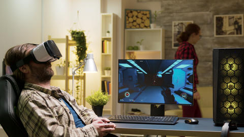 Man sitting on gaming chair playing video games Live Action