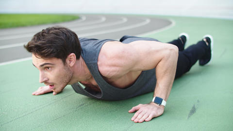 Sport man doing push up exercise at stadium. Fitness man doing pushups exercise Live Action