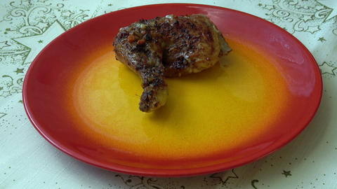 Grilled chicken on plate. Delicious roast chicken Live Action