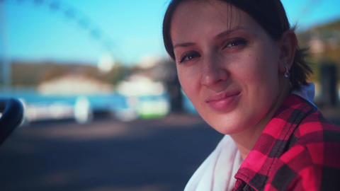 Portrait of a charming girl in a red-black plaid shirt with dark hair. Girl Live Action