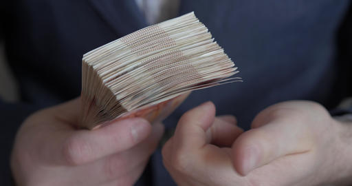Male hands counting money. Russian money banknotes of 5,000 rubles Live Action