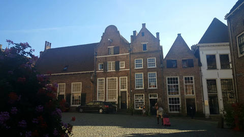 Tourist with suitcase in alley in Deventer Footage