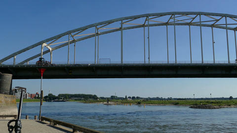 On the banks of the river IJssel with Wilhelmina bridge in background Footage